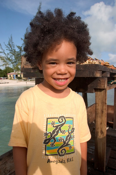 Smiling young Lawrence Wheatley, grandson to Lowell Wheatley, the founding owner of Anegada Reef Hotel, Anegada, British Virgin Islands (BVI), West Indies, Caribbean.