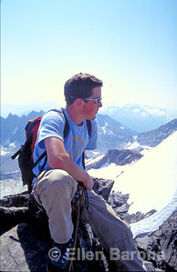 CMH hiker, peak of Mt. Syphax, Canadian Mountain Holidays, Helihiking, Bobbie Burns Lodge, Purcell Mountains, British Columbia, Canada