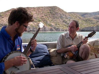 Expedition leader, Kevin Martin, and passenger, Mike Derson, strumming aboard Safari Quest, Sea of Cortez, Baja California Sur, Mexico.