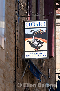 The Dordogne region is famous for its foie gras, Godard sign, Domme, France.