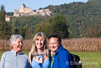 Wayfarers Eve Jursch, Michele Priest and Scott Edmondson with Castlenaud in the distance, Dordogne River valley, France.