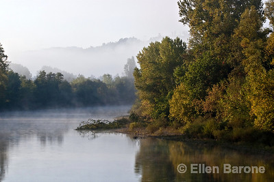 Morning mist shrouds the Dordogne River at la Roque Gageac, France.