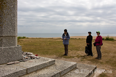 Wayfarers pay respects on D-day at the Torcross memorial, Slapton Sands beach, Devon, England, U.K..