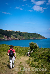Wayfarers hiking the south Devon coastline along the English Channel, South West Coast Path (National Trail) England, U.K.