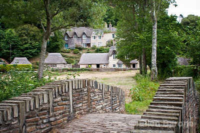 Thatched cottages and stone bridge near Blackpool Sands beach,  Devon, England, U.K.