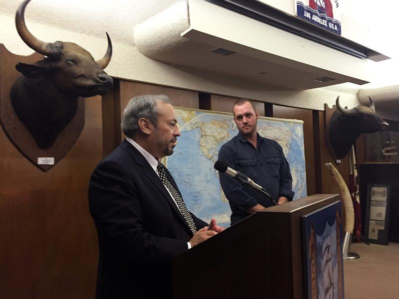 Jeff Holmes, president, inducting Dan Brown.<br /> February 25, 2016