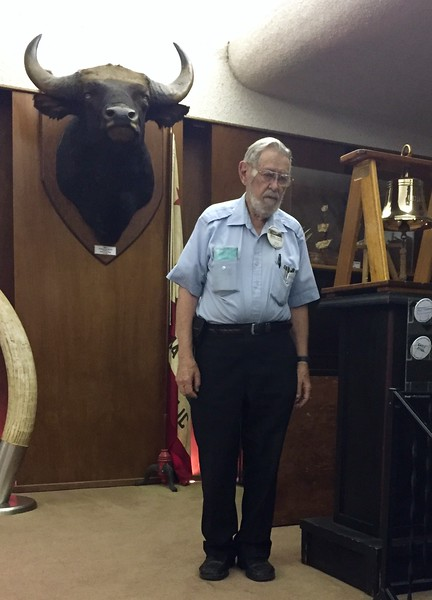 """Bernie Harris rings the club bell and stands in a moment of silence for members OTGA.<br /> """"Honoring Paul MacCready"""" presentation<br /> May 12, 2016"""
