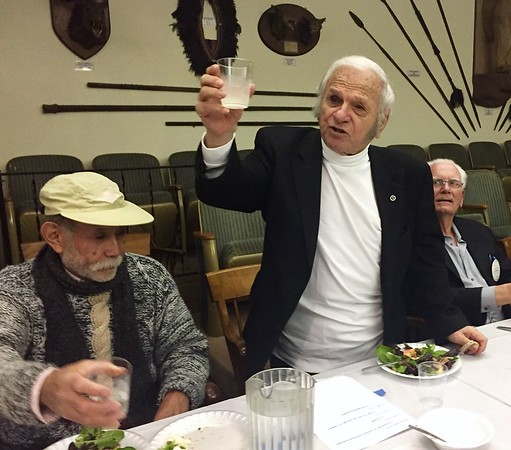 Bob Silver, longest club member, proposes a toast