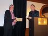 Jim Dorsey receives plaque and medallion of appreciation.