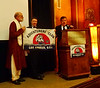 On behalf of member #1194, Wayne White, Station Manager, Larry Stern & Chuck Brill, return the Expedition Flag from the South Pole.