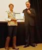 """Larry Schutte presents ACLA Certificate of Appreciation to NOHA speaker, Edie Littlefield Sundy - """"Mission Walker""""."""