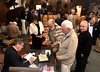 """Colonel Greg Raths, USMC (Ret), autographing his book """"9 Lives of a Fighter Pilot"""" for Eric Flanders.<br /> January 10, 2019"""