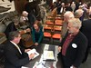 """Colonel Greg Raths, USMC (Ret), autographing his book """"9 Lives of a Fighter Pilot"""" for Bill Price.<br /> January 10, 2019"""