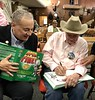 Roy Roush, WWII veteran, autographing books for Jeff and Bob.<br /> ACLA 75th D-Day anniversary commemoration<br /> June 6, 2019