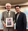 "Richard Higbie, Korea War veteran, receives commemorative book ""Korea Reborn"" from Kevin Lee.<br /> May 30, 2019"
