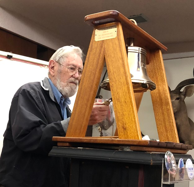 Bernie Harris rings the club bell 8 times in remembrance of Shane Berry and others On The Great Adventure.
