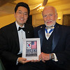 "Kevin Lee, Korean-American, presents Buzz Aldrin with ""Korea Reborn"" at the Night of High Adventure, 2014. Buzz is a Korean War veteran who, as a jet fighter pilot,  flew 66 missions and shot down two Migs. Kevin interviewed Buzz on stage for more than an hour,  discussing his life and Apollo 11 mission to land and walk on the moon on July 20, 1969."