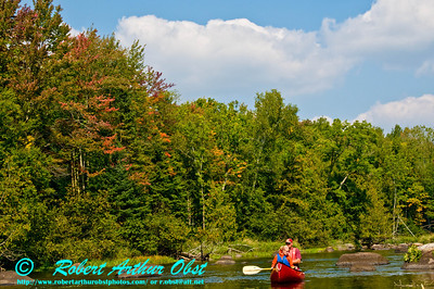 Early autumn tandem canoeing the crystalline upper Wolf River near Lily (USA WI)