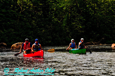 Whitewater Open Canoeists Cruise Sun Dappled Riffles between Cedar and Sherry Rapids on the Wolf River (USA WI White Lake)