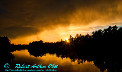 Dazzling Crimson Autumn Sunset from a canoe through Fog and Storm over Wisconsin River near Tomahawk (USA WI Tomahawk)