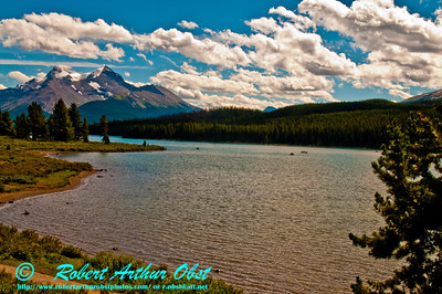 Hikers and canoeists explore mountain and glacier guarded turquoise Maligne Lake within Jasper National Park (Canada Alberta Jasper)