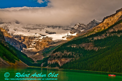 Glaciated mountains and a network of hiking trails encircle canoeists on emerald Lake Louise (CAN Alberta Lake Louise)