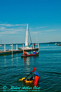 """Kayak Eskimo rolling, Canoeing and Sailing by the WI Memorial Union """"UW Hoofers"""" Boat house on Lake Mendota (USA WI Madison)"""