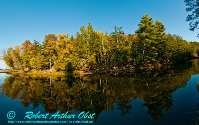 Canoeist's view of boreal forest autumn reflections at the mouth of the Presque Isle River by Lake Superior within Porcupine Mountains Wilderness State Park and Presque Isle River Scenic Area (USA MI Ontonagon)