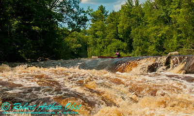 Canoeist Charlie Frisk approached the crux drops of the Dalles of the Wolf at a river flow of 744 CFS on the wild Wolf River Section 4 within Menominee Indian Nation  or Menominee County (USA WI Keshena)