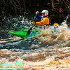 Solo open canoeist blasting through the breaking waves of Gilmores Mistake Rapids at 1400 frigid CFS or 25 inches on Section 3 of the wild Wolf River within Langlade County (USA WI White Lake; Obst FAV Photos 2013 Nikon D300s Adventures Paddlesport Image 5238)