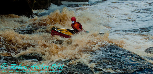Close-up of Bob Obst's open canoeing sweet route over Big Smokey Falls at 744 CFS on the wild Wolf River Section 4 within Menominee Indian Nation or Menominee County (USA WI Keshena)