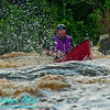 Close-up of exploding whitewater encircling open canoeist Charlile Frisk as he approaches the final drop of Big Smokey Falls at 744 CFS on Section 4 of the wild Wolf River within Menominee Indian Nation or Menominee County (USA WI Keshena; Obst FAV Photos 2012 Nikon D300s Adventures Paddlesport Image 1563)