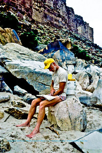 The late Ray McLain reading at a Colorado River camp within Grand Canyon National Park (USA AZ Grand Canyon)