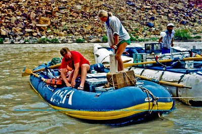 Guides prepare raft at Badger Camp Mile Eight along Colorado River within Grand Canyon National Park (USA AZ Grand Canyon)