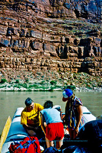 Rafters preparing for departure within the Colorado River's North Canyon of Grand Canyon National Park (USA AZ Grand Canyon)