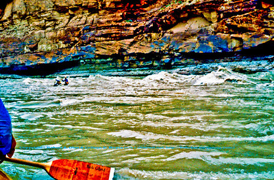 Tandem whitewater canoeists playing in Colorado River rapids within Marble Canyon of Grand Canyon National Park (USA AZ Grand Canyon)