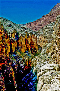Colorful contrasts of redrock canyons and blue skies border the Colorado River within Grand Canyon National Park (USA AZ Grand Canyon)