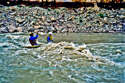 Tandem whitewater canoeists the late Ray McLain and partner playing in Colorado River rapids within Marble Canyon of Grand Canyon National Park (USA AZ Grand Canyon)