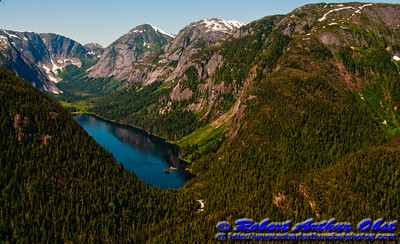 Granite mountains tower over remote blue lakes and streams within the rugged Misty Fiords National Monument (USA Alaska Ketchikan)