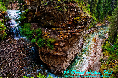 Hiker's view of the serpentine Johnston Creek and Johnston Canyon within Banff National Park (Canada Alberta Banff)