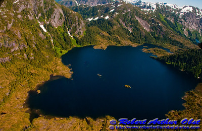 Granite mountains may rise three to four thousand feet over remote lakes or estuaries within the rugged Misty Fiords National Monument (USA Alaska Ketchikan)