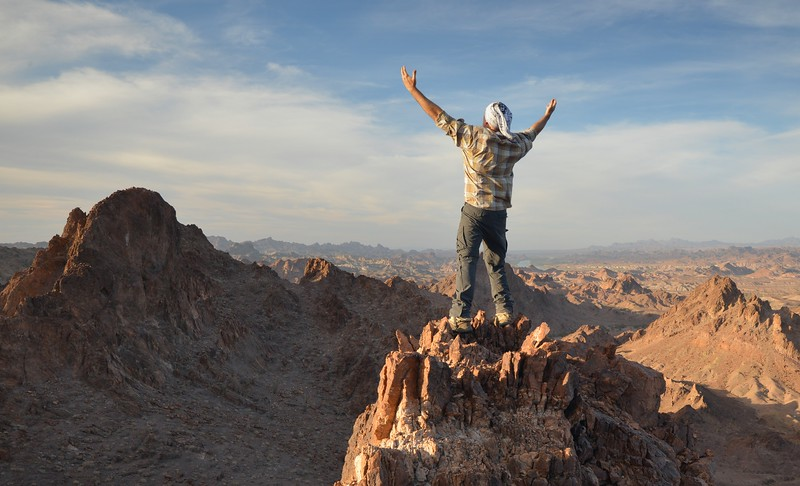 Hiker With Outstretched Arms on the Summit