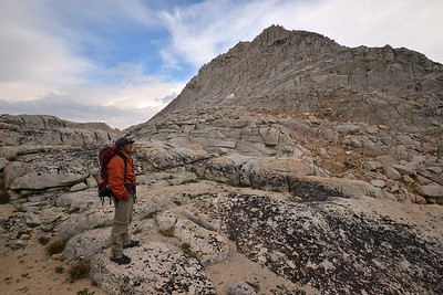 Hiker Looking at Feather Peak From the Granite Shelf