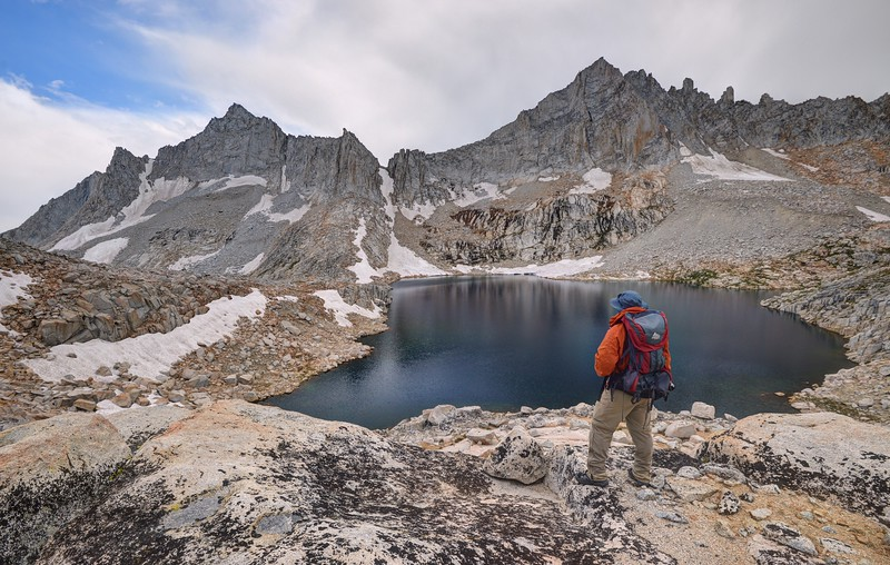 Hiker Enjoying the View of Feather Peak and Upper Royce Lake