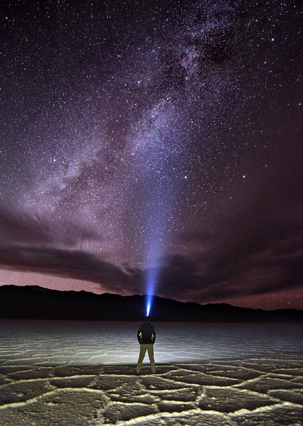 Hiker Illuminates the Nighttime Sky With His Headlamp