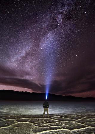 Hiker Illuminates the Nighttime Sky With His Headlamp