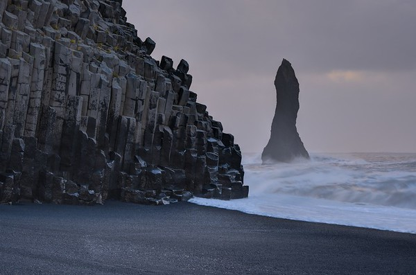 "One of the ""Three Trolls"" and the Reynisdrangar (volcanic rocks)"