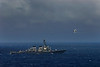 USS Fitzgerald (DDG - 62) and an F18 Superhornet in the Western Pacific. Sep 2009.