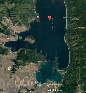 Satellite view of Flat Lake, Kerr and its dam at bottom