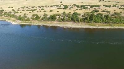 11-Fishermen drift on Missouri below confluence